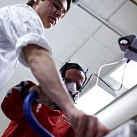 PhD Student Morten B. Randers is testing the physical shape of test subject Johnny Aarres. Photo: Flemming Schiller.